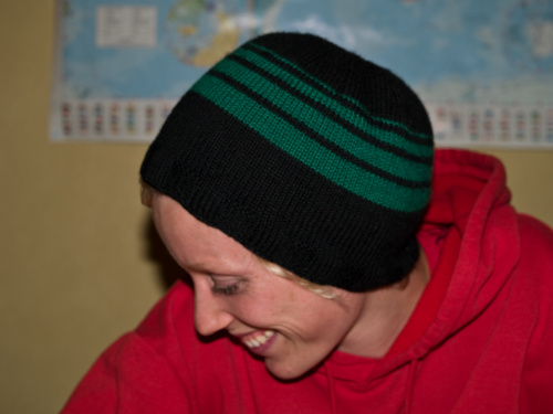 hand knitted black and green beanie hat