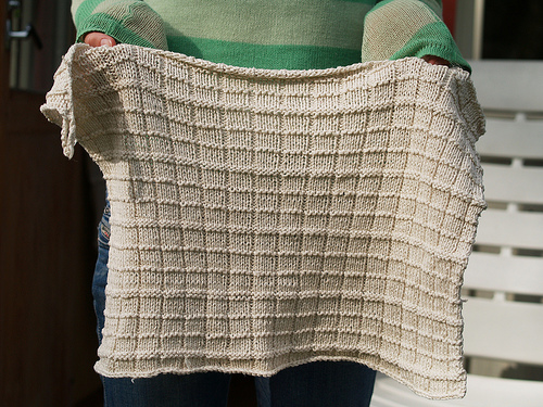 Knitted white hand towel with squares