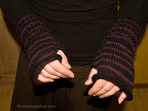 hand knitted black and purple wrist warmers